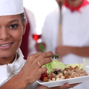 Female-Chef-Carrying-Plate